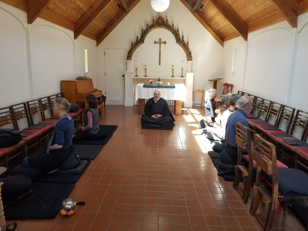 Seven Soto Zen Buddhist practitioners sit zazen in St. Aidan's Episcopal church in Bolinas, CA.